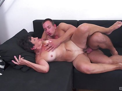 Mature enjoys young nephew fucking her groove on in the movies
