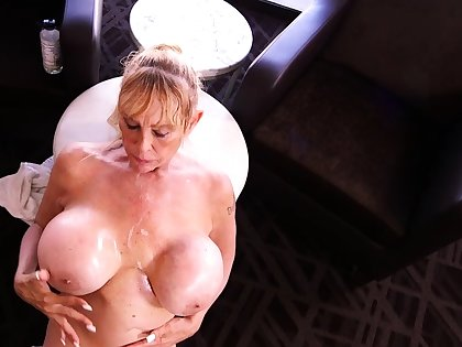 Top-drawer blowjob from the mature busty blonde