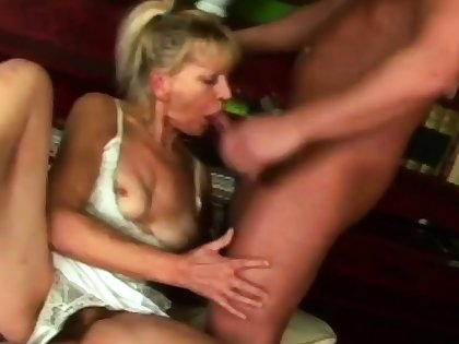 Hot granny is sucking her neighbour's big cock on a difficulty couch.