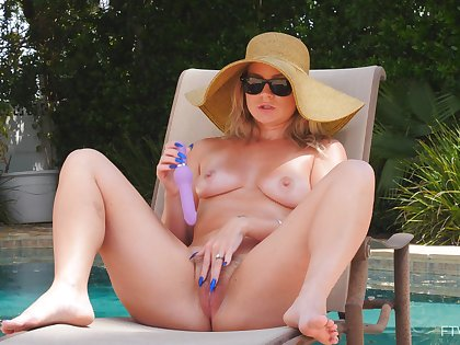 Horny wife Lisey loves pleasuring her pussy by the outdoors pool